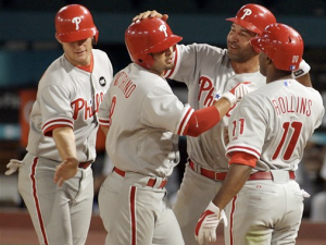 Victorino is greeted at the plate by teammates after his ninth-inning grand slam. (AP Photo/Jeffrey M. Boan)
